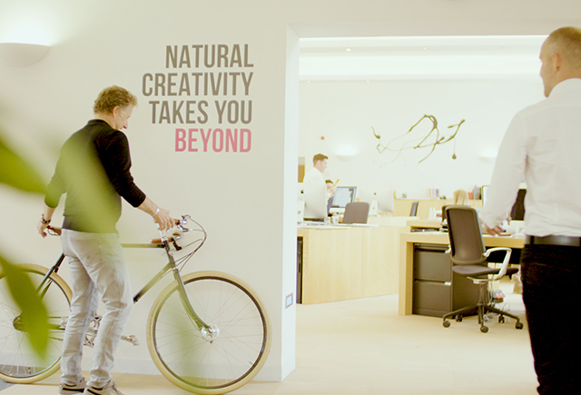 Man holding bike in office