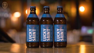 Three Lucky Saint bottles in a row
