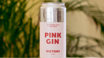 pink gin can in front of plants